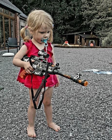 Lena trying one of Theo's toys. I will probably do a sketch of this photo to do denounce the use of weapons #weapon #noweapon #gun #nogun #noviolence #photography