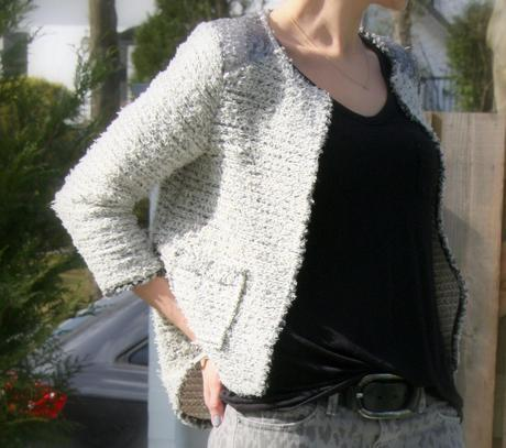The tweed cardigan and leopard jeans