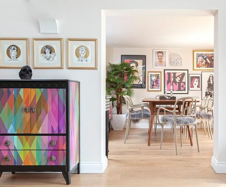 Eclectic living room with colourful furniture and unusual gallery wall.
