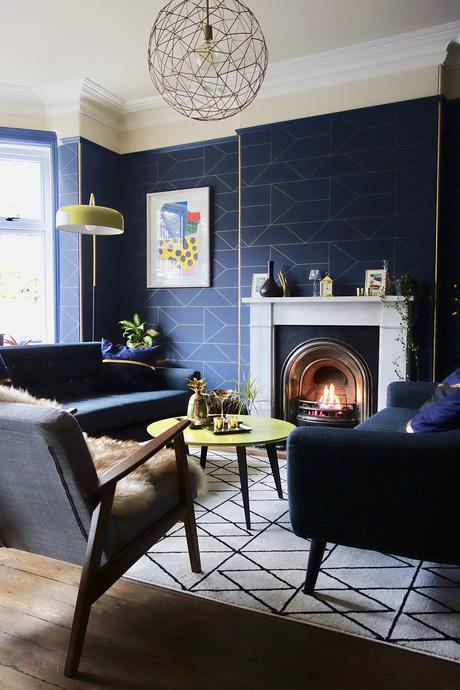 Geometric navy blue wallpaper in a contemporary living room.