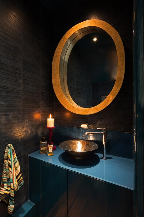 A dark and moody bathroom with modern fittings.