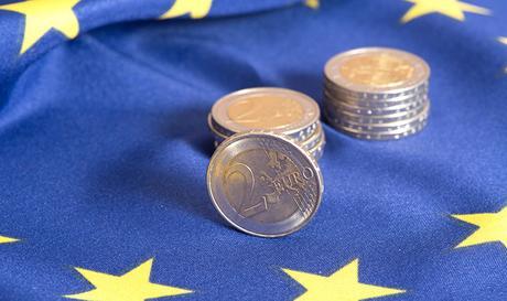 Euro coin on EU flag