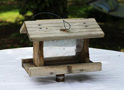 weathered wood bird feeder and stand