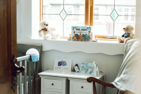 A shot that looks like we've peeked in to a little boys nursery room at home with his Mr Men collection and blue, grey and white themed decor