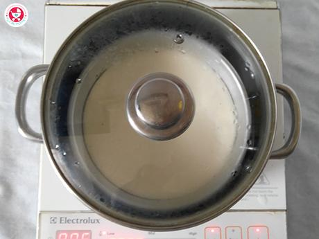 Now once our steamer is ready, add a thick pinch of baking soda to the green batter and mix well.