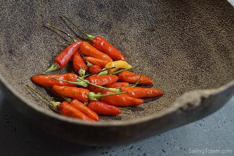 spicy red chiles in a calabash bowl
