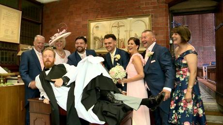 the priest at st saviours church in the wirral photo bombs the formal signing of the register shot by diving on the table for the photo and video