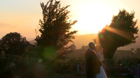 a bride and groom pull each other in close and share a kiss for their wedding video at their Shrewsbury wedding