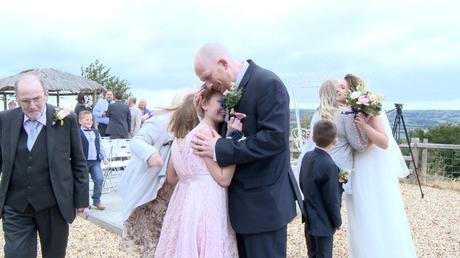 a dad hugs his daughter close after he's gotten married at Abels Harp