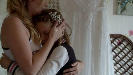 a bride mum hugs her daughter close as they have an emotional moment on the wedding video after talking about missing her Mum