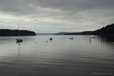 Overcast skies and the silhouette of boats in a Puget Sound evening