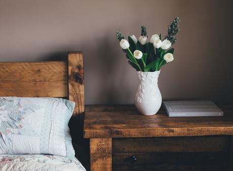wooden bedframe flowers book nightstand wabi-sabi
