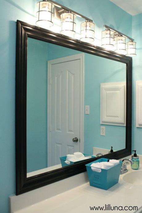 Bathroom Mirror Ideas 8. Black-Framed Mirror in Blue Bathroom - Harptimes.com
