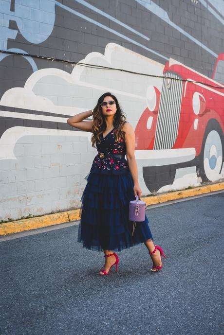 j crew embroidered peplum top, tule skirt asos, navy blue monochromatic outfit, street style, party look, studded sandals, bright pink lips, bucket bag, purple bag, myriad musings