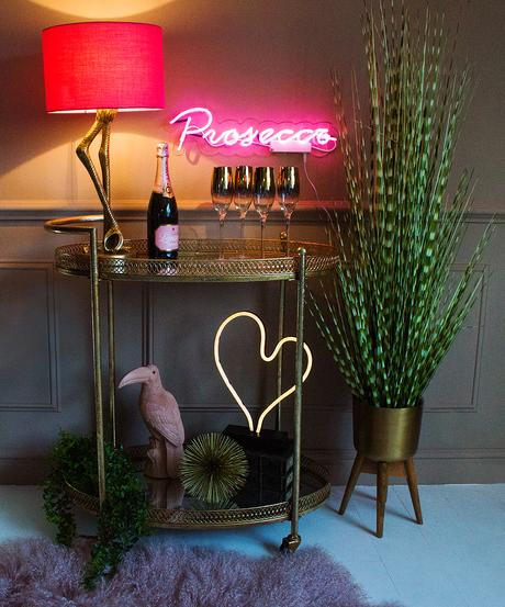 How to style a drinks trolley. Pink neon lights.