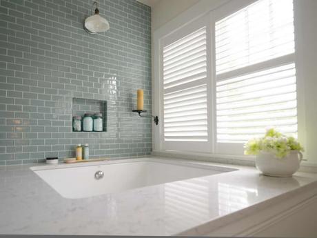custom plantation style shutters next to bathtub natural light