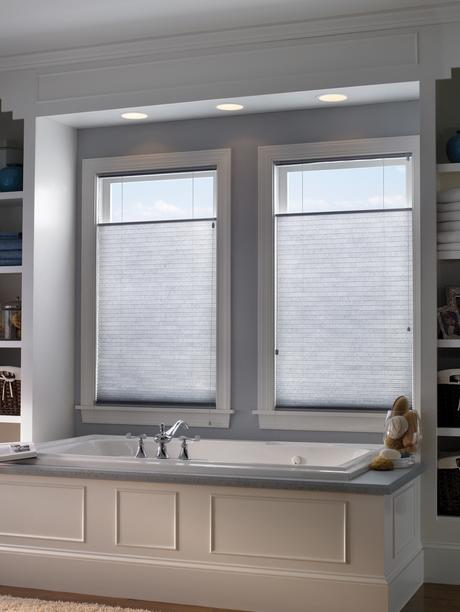 natural light bathroom with closed white shades