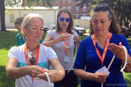 three women work on sailing knots at Cruisers University