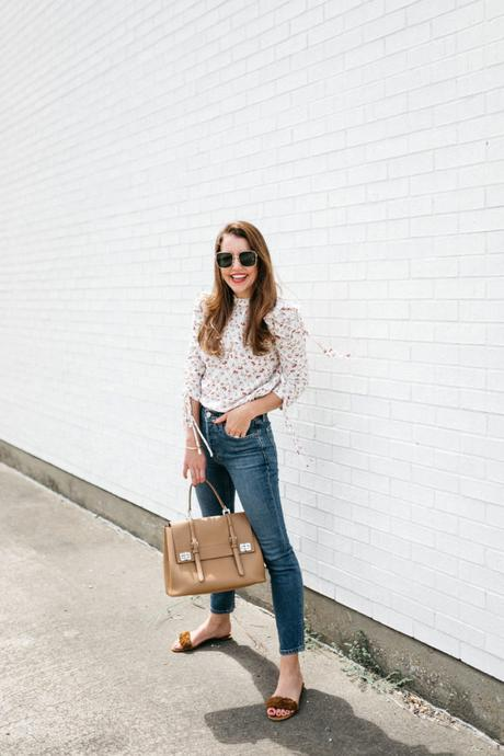 Amy Havins wears jeans and a blouse.