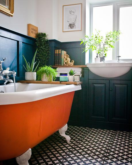 Colourful family bathroom with orange claw foot tub