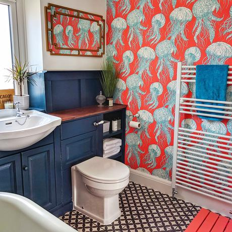Colourful family bathroom with red jelly fish wallpaper