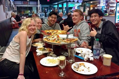 Teenagers smile for camera at pizzeria in Portland