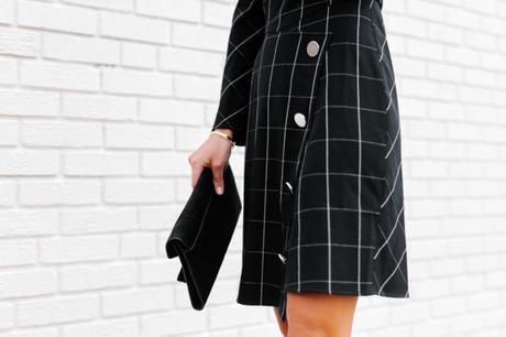 Amy Havins wears a black contrast plaid shoshanna dress.
