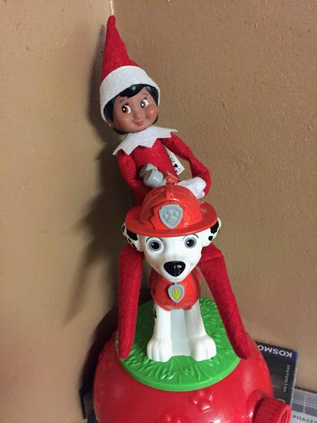 An elf doll riding a Dalmatian dog
