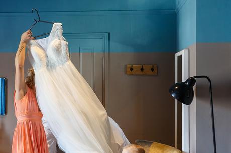 taking down the wedding dress