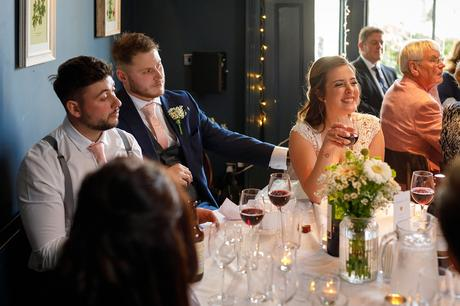 the bride listens to her brothers speech