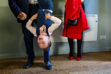 a page boy hangs upside down