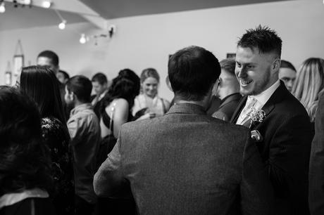 the groom speaks to his guests