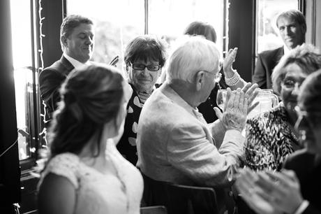 the bride smiles at a guest