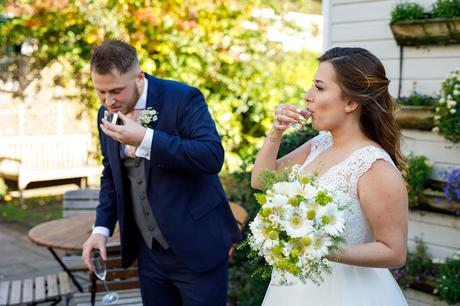 bride and groom drink shots of tequila