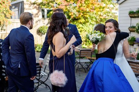 the bride hugs her friends in the garden