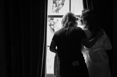 the bride looks out to see the groom