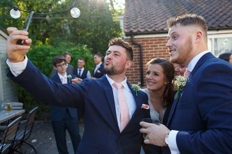 a quick selfie with the bride and groom