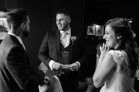 bride and groom smile with the celebrant