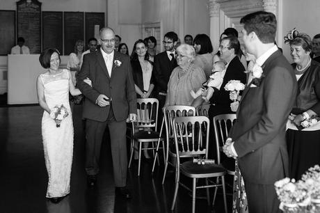 susie and her dad walk down the aisle