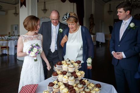 susie inspects the cake with her mum