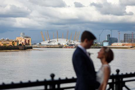 bride and groom with greenwich in the background