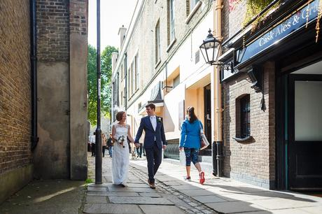 bride and groom walking through the streets of greenwich