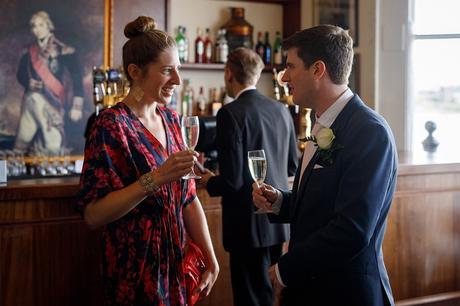 steve talks to a wedding guest
