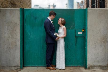 susie and steve in front of a thames floodgate