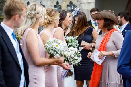 bridesmaids talk to wedding guests