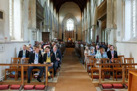 wedding guests waiting inside dennington church