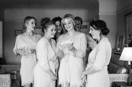 bridesmaids look at a selfie