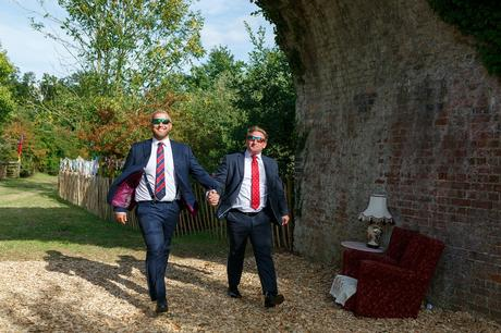 wedding guests arrive under the railway arch