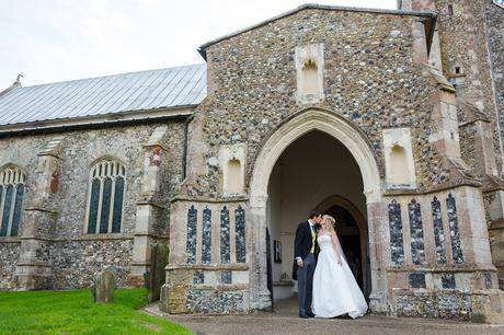 kissing in the doorway of dennington church