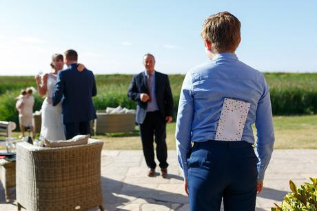 the pageboy hides a birthday card from the best man